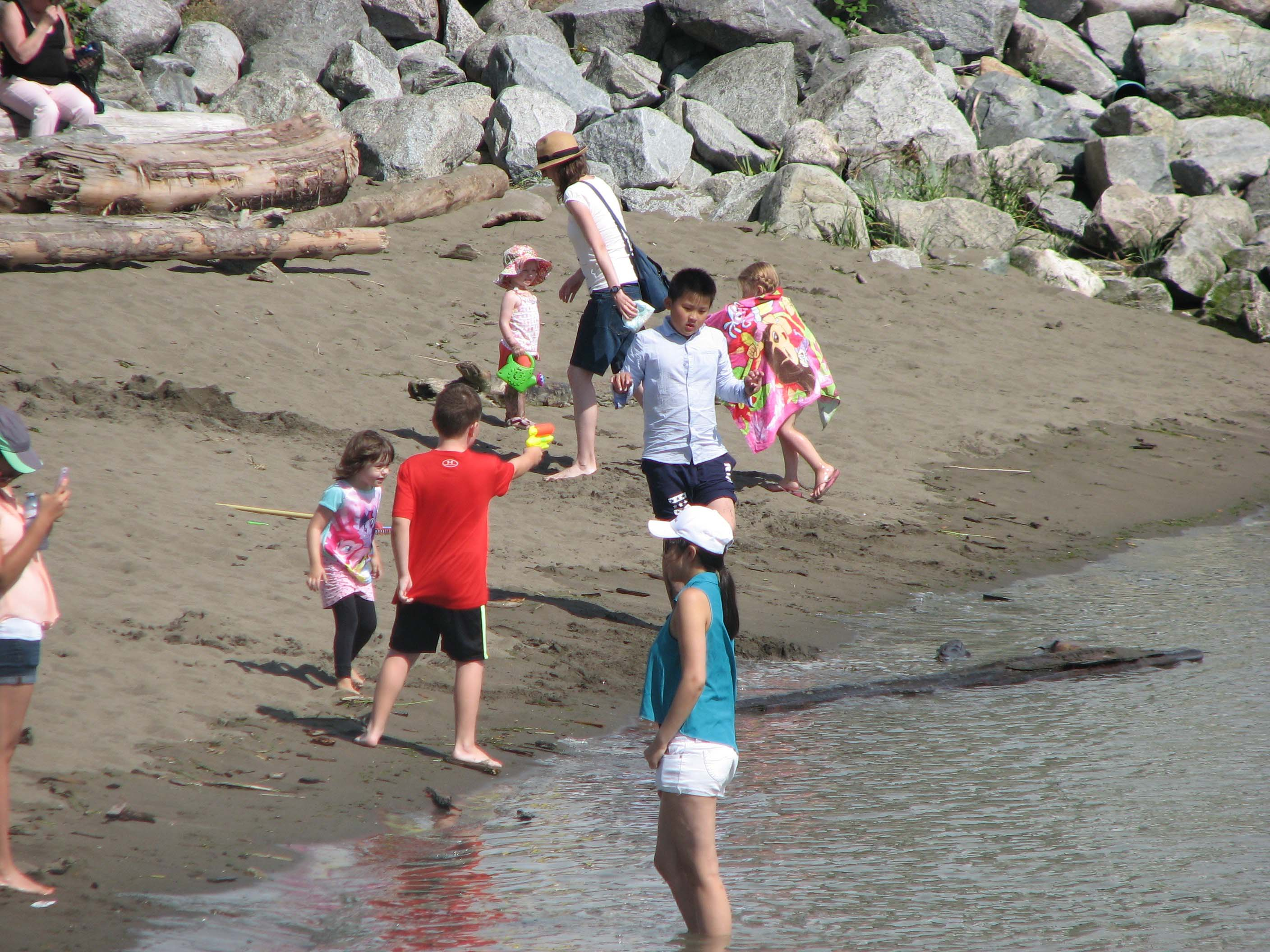 Kids play on the beach at Garry Point Park