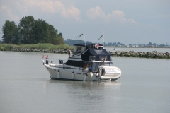 A pleasure boat sails into Steveston Harbour