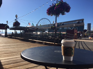 Seattle Pier with Starbuck Coffee Cup