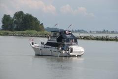 A pleasure boat sails into Steveston Harbour