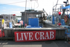 Bow of Crabbing Boat with Live Crab Sign